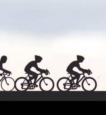 Miniature cyclists on a window sill